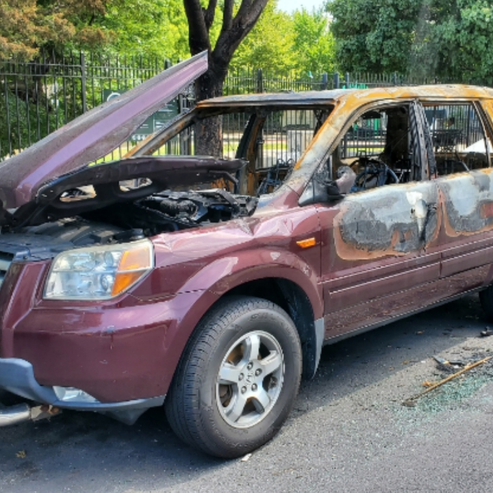 Vehicles in the Bronx torched. Image by Vaughn Lowery of 360 MAGAZINE.