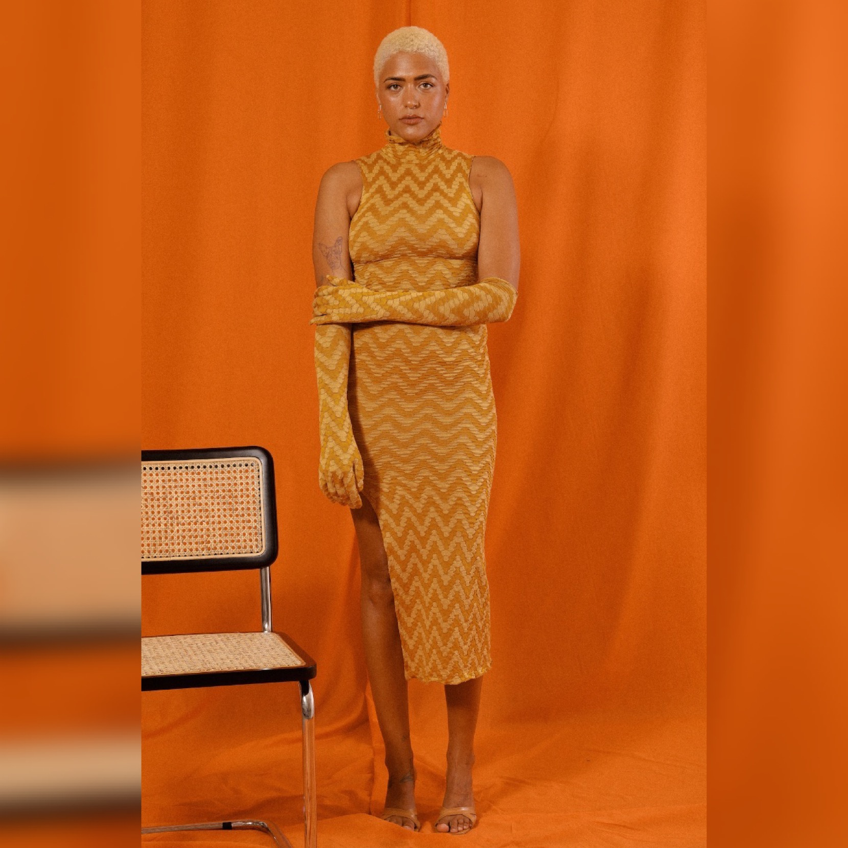 DALMA TURTLENECK TANK DRESS in GOLDENROD CHEVRON KNIT by Saint Mojavi for use by 360 Magazine
