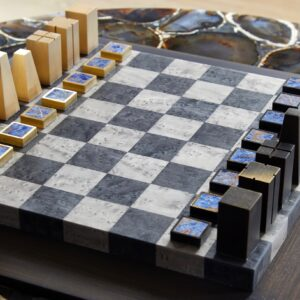 Bespoke Lapis Chessboard Set' in bronze, brass, veneers & lapis lazuli, edition of 20, 40 x 40cm, (£6,250) (AEDITIONS / Marie Soliman)