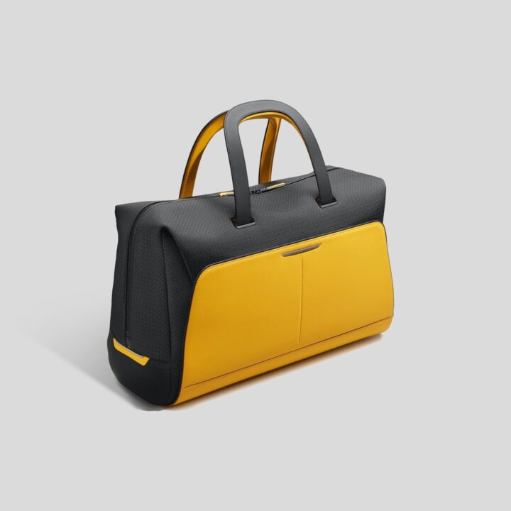 Black Badge Escapism Luggage Bold, 24hr Weekend Forge Yellow bag product image via Gerry Spahn at Rolls-Royce Motor Cars for use by 360 Magazine